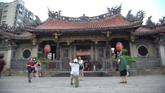4K Tourist people taking photograph with camera phone of Longshan Temple-Dan Stock Footage