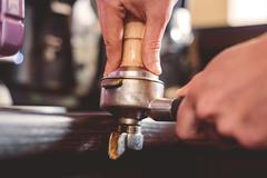 Temper used by hands of barman Stock Photos