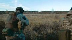 Ukrainian soldier run on the field Stock Footage
