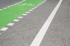 Cycle lane on road surface Stock Photos