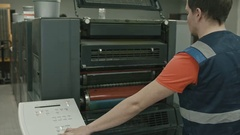 Working monitors technical process on polygraph industry process, color printing Stock Footage