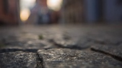 Old city paving stone narrow road with pedestrians Stock Footage