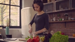 Lady cooking vegetarian lunch Stock Footage