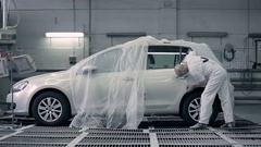 The worker wipes a white car. Stock Footage