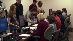 Young women vote early at Toledo polling place for 2016 presidential election Stock Footage