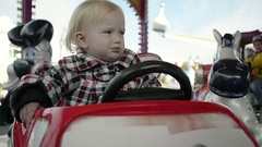 Close Up of Child Riding on a Carousel in Amusement Park Stock Footage