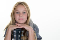 Preteen blond young girl with guitar isolated on white Stock Photos