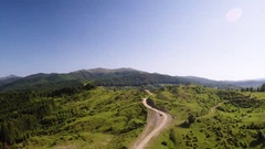 Road through Green Forested Hills Stock Footage