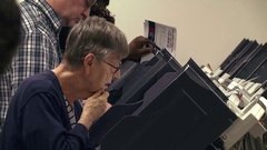 CU of woman at voting terminal in early voting for 2016 presidential election Stock Footage