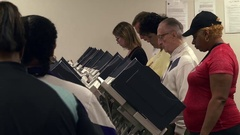 Voters at electronic terminals cast early ballots in 2016 presidential election Stock Footage