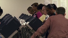 Voters at electronic terminals cast early ballots for 2016 presidential election Stock Footage
