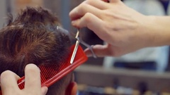 Master men's haircuts works with the client's hair Stock Footage