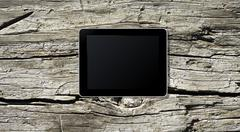 Tablet PC on a wooden board for advertisment Stock Photos