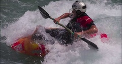 Kayaker playin g in the wave of the rapids flips. Stock Footage