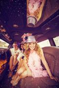 Composite image of female friends having fun in limousine Kuvituskuvat
