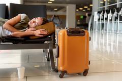 Beautiful girl napping near luggage Stock Photos