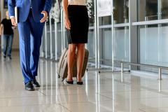Businessman and woman traveling on official journey Stock Photos