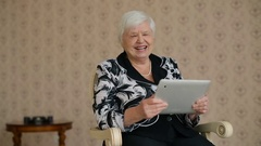 Cheerful Senior Woman connected by Skype Stock Footage