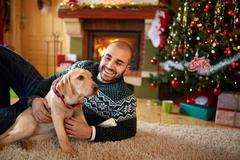 Man with his dog on Christmas eve Stock Photos