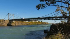 Cars and trucks move on Olfusarbru bridge over Olfusa river in Selfoss city Stock Footage