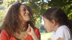4K Happy affectionate mother & daughter spending time outdoors Stock Footage