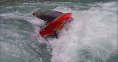 Two Kayaker Flip Out of the White Water Together. Stock Footage