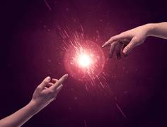 Touching hands light up sparkle in space Stock Photos