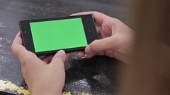 Woman using smartphone with green screen Stock Footage