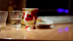 Ukranian Man Drinks Alcohol And Puts it on The Table in Ukraine in Marioupol Stock Footage