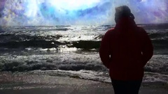The girl on the beach and a passing galaxy on horizon Stock Footage