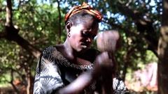 Africa woman preparing Caju juice for wine fermentation in village - Guinea Stock Footage