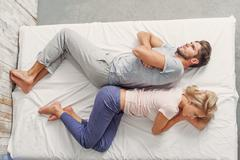 Offended loving couple in bedroom Stock Photos