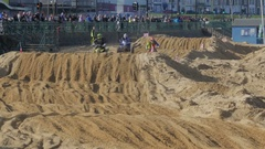 Tourists watching Quad Bikes Racing at Margate Beachcross Stock Footage