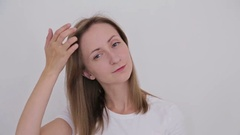 Young pretty woman fixing her hair Stock Footage