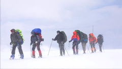 Strong wind mountaineers climb the mountain. Motivation. Stock Footage