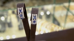 Women jewelry on a stand-round visibility. Earrings with diamonds on in Stock Footage
