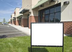 Blank Sign In Front of New Retail Strip Center Stock Photos