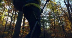 Hiker with a backpack walking on forest path Stock Footage
