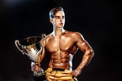 Bodybuilding champion with cup Stock Photos