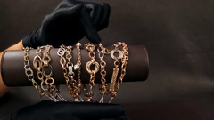 Jewelry in the store, Sold in black gloves shows gold jewelry in the store, a Stock Footage