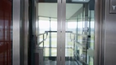 4K Astronaut taking the elevator in modern office building Stock Footage