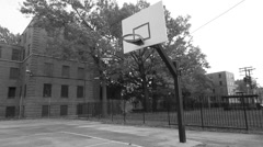 Black and white still shot of a basketball hoop Stock Footage
