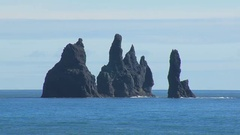Reynisdrangar, basalt sea stacks, in southern coast of Iceland, in sunny day Stock Footage