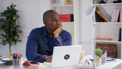4K Pensive businessman working at his desk in home office Stock Footage