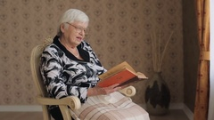 Old woman reading book Stock Footage