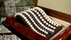 Jewelry made of pearls, Pearl bracelets on a pedestal decoration for glamorous Stock Footage