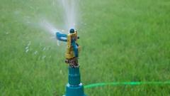 Head garden sprinkler slow motion hd footage Stock Footage