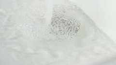 Draining the water into the white sink Stock Footage