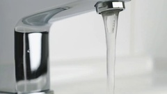 Flow of water is pouring from the stylish faucet Stock Footage