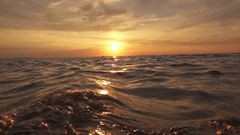 SLOW MOTION: Small boat in the distance swaying on the waves of rippling sea Stock Footage
